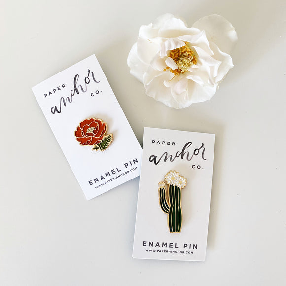 Two enamel pins from Paper Anchor Co. in floral designs
