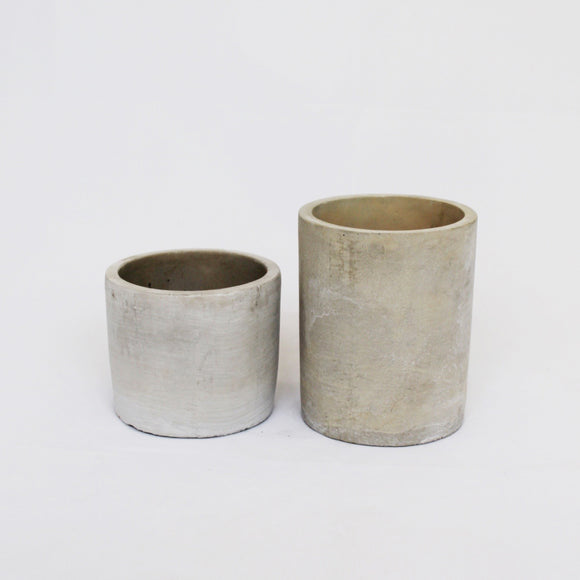 Grey cement cylindrical vases in varied heights