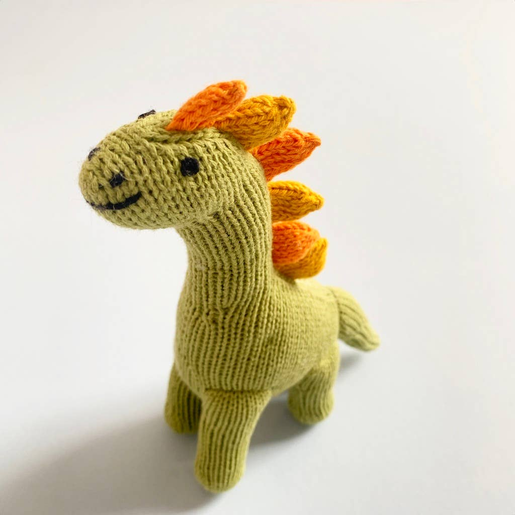 Spring green long-necked dino knitted toy with orange scales along neck
