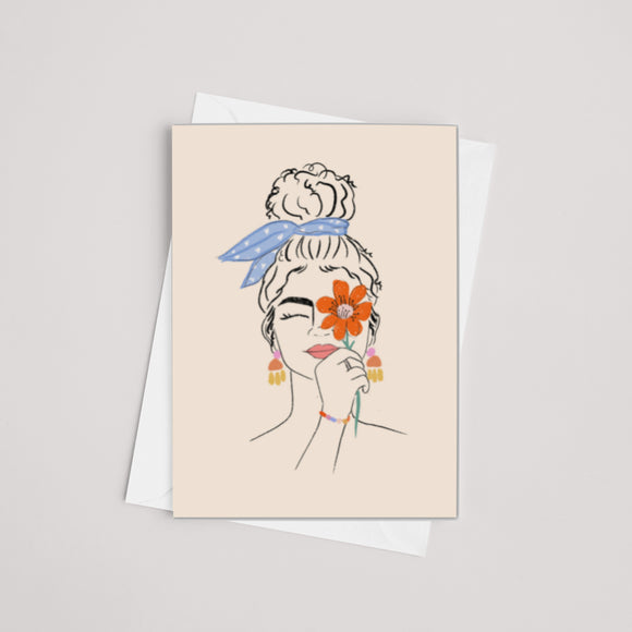 Floral face illustrated greeting card - woman holds orange flower over her eye