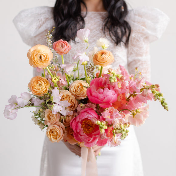 Pink and peach floral bridal bouquet with peonies from Native Poppy