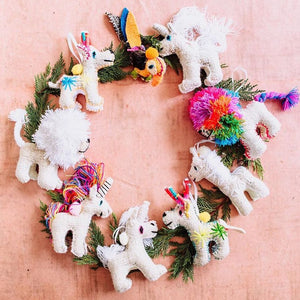 Colorful mexican stuffy ornaments styled with a green wreath