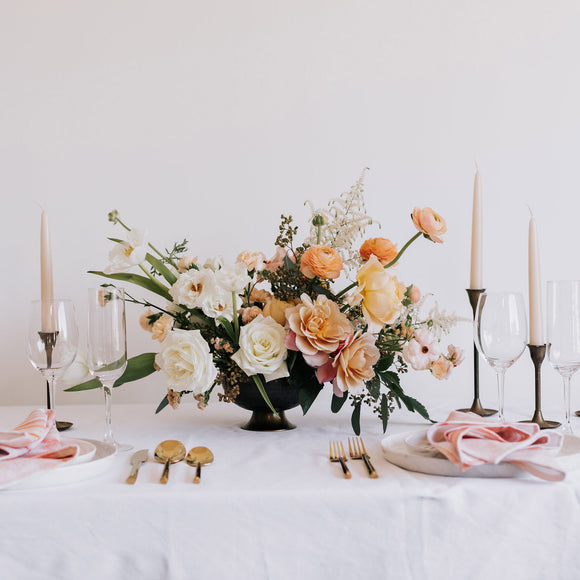 Floral compote arrangement with peach and white flowers