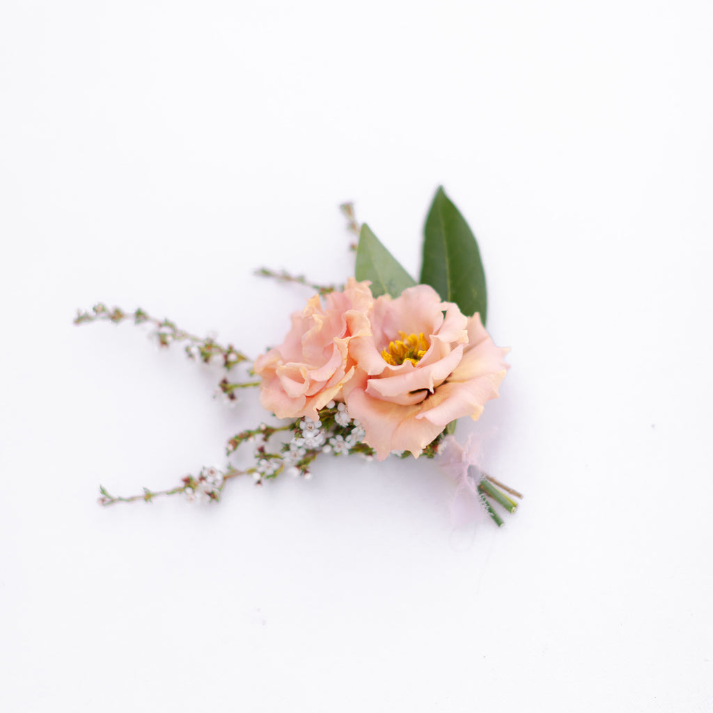 Peach floral boutonniere from Native Poppy in San Diego