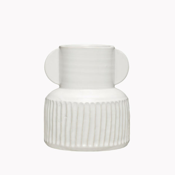 White ceramic vase with vertical striped carving