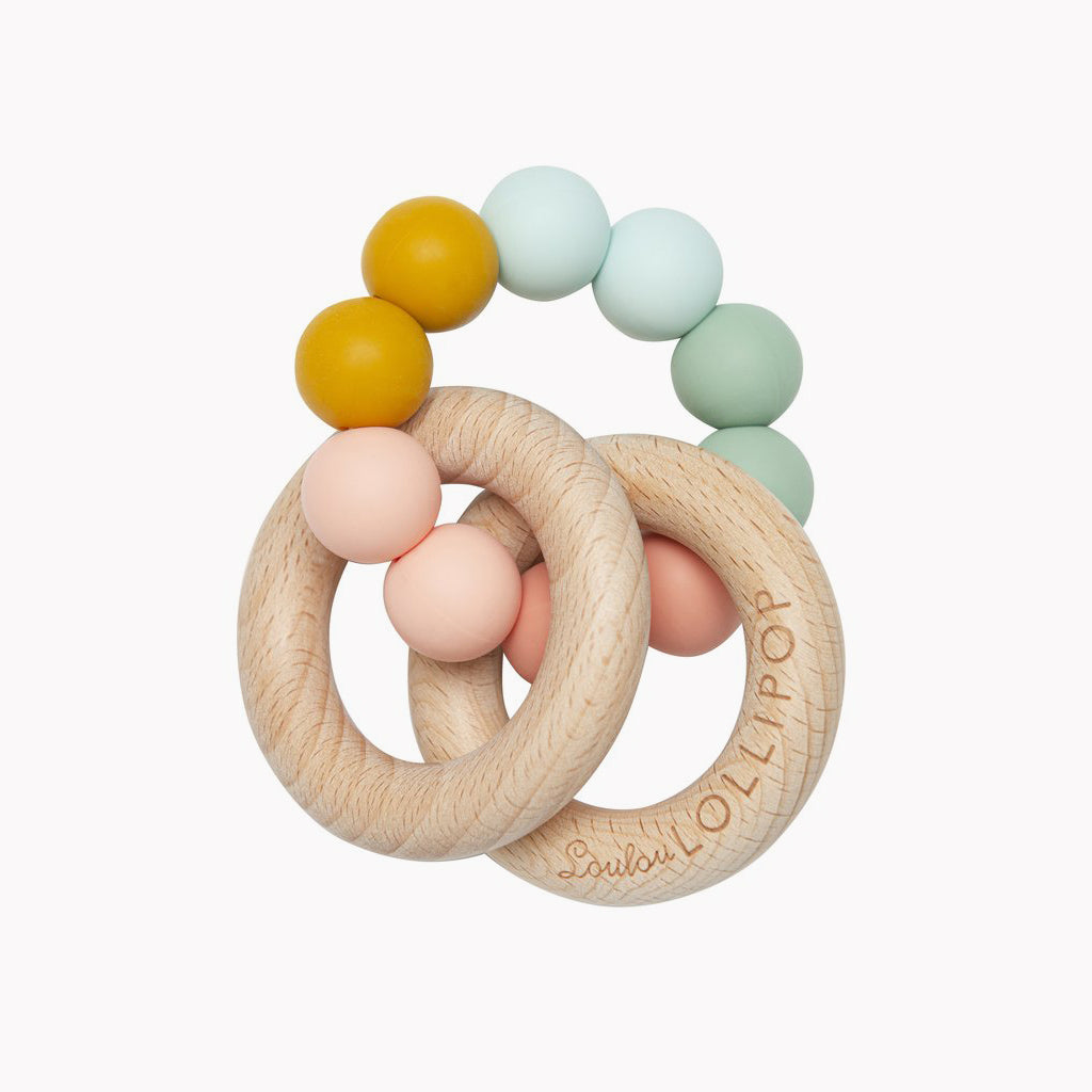 Rainbow Teether featuring silicone beads and two beechwood rings