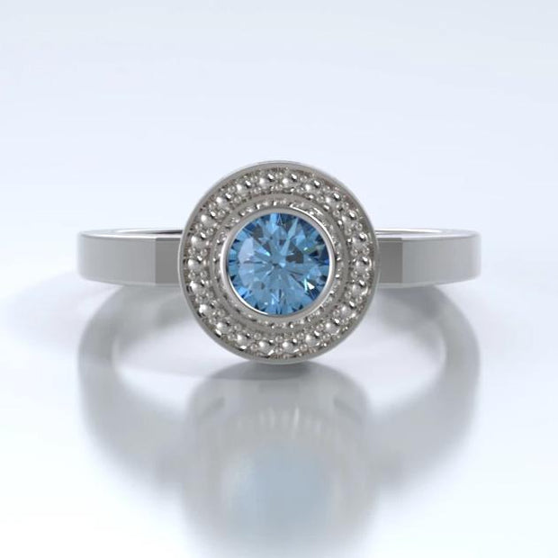 Mystere Solitaire Cremation Ring in 18k White Gold with Blue Topaz