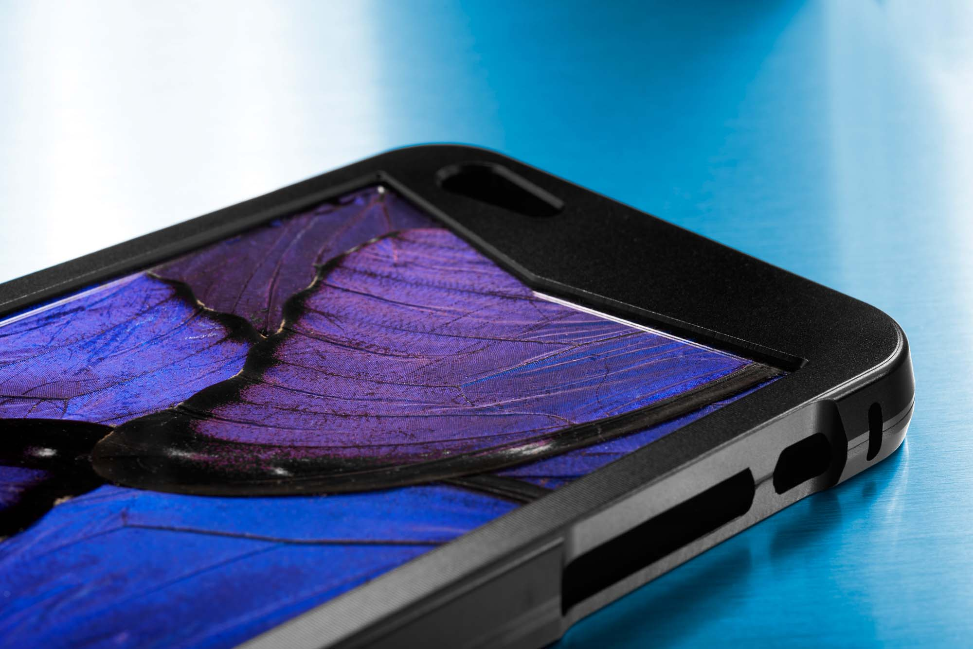 The one of a kind KHAMAMA BLUE 1874 iPhone case with real blue morpho butterfly wing art embodies the beauty of nature
