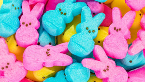 A collection of pink and blue bunny-shaped peeps alongside the classic peeps