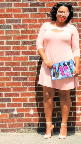 pink dress with denim clutch
