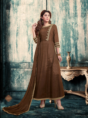 Brown Colored Banglori Silk And Net Suit.