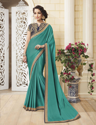 Green Colored Silk Crepe Zari embroidery and lace border Saree
