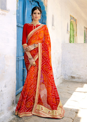 Red And Orange Color Georgette Lace Border Work Bandhani Saree With Un-Stitch Blouse
