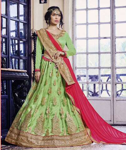 Green & Peach Colored Net Heavy Embroidered Semi Stitched Lehenga Choli