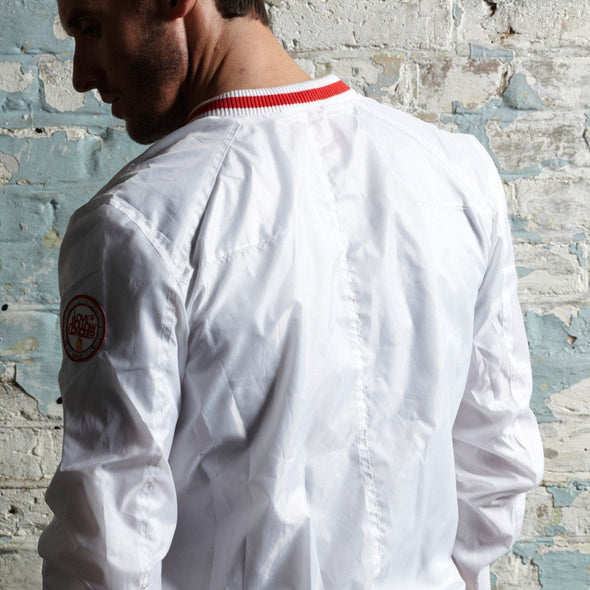 red tipped collar on white track jacket
