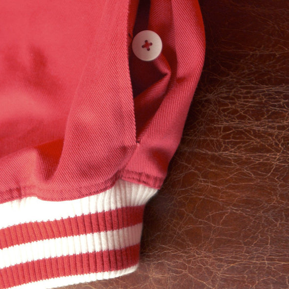 Detail red and white waistband on red track jacket