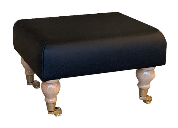 Aged Black Leather Footstool with Natural Caster Legs