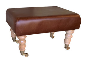 Aged Rust Leather Footstool with Natural Caster Legs