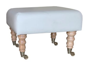 Aged Ivory Leather Footstool with Natural Caster Legs