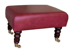 Aged Claret Leather Footstool with Mahogany Caster Legs