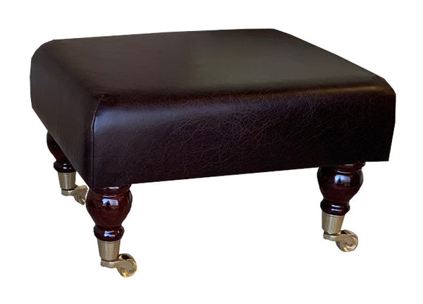 Aged Dark Brown Leather Footstool with Mahogany Caster Legs
