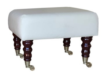 Aged Ivory Leather Footstool with Mahogany Caster Legs