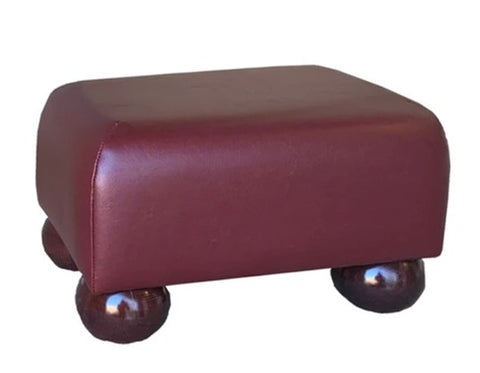 Aged Claret Leather Footstool with Mahogany Bun Feet