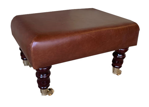 Aged Rust Leather Footstool with Mahogany Caster Legs