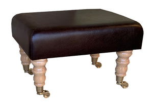 Aged Dark Brown Leather Footstool with Natural Caster Legs