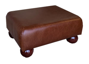Aged Rust Leather Footstool with Mahogany Bun Feet