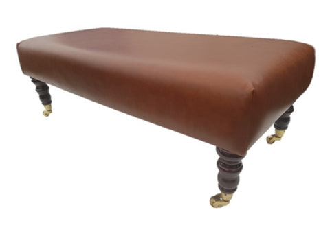 Luxury Upholstered Long Footstool in Aged Rust Leather with Dark Caster Legs - Footstools Direct