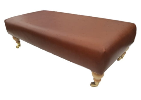 Luxury Upholstered Long Footstool in Aged Rust Leather with Light Caster Legs - Footstools Direct