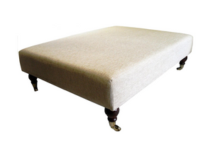 Luxury Upholstered Large Footstool in Natural Chenille Fabric with Dark Caster Legs - Footstools Direct