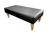 Luxury Upholstered Long Footstool in Aged Black Leather with Light Turned Legs - Footstools Direct