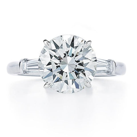 round brilliant tapered baguette side stone engagement ring