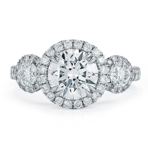 halo three-stone engagement ring