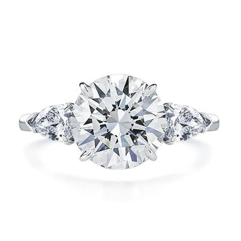 round brilliant with pear side stones engagement ring