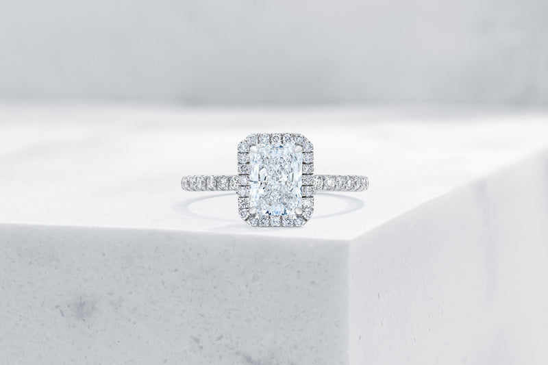 Delancey VOW by Ring Concierge radiant halo engagement ring with micropave band in platinum. 33281357643864