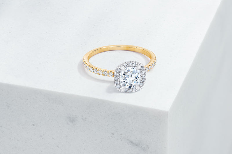 Delancey VOW by Ring Concierge antique-style cushion halo engagement ring with micropave band in yellow gold. 33281357873240