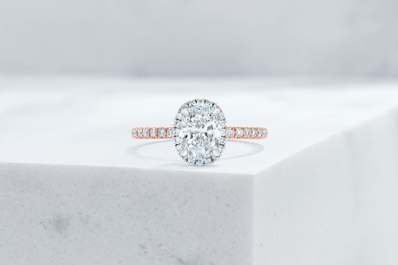 Delancey VOW by Ring Concierge oval halo micropave engagement ring in rose gold. 33281357316184