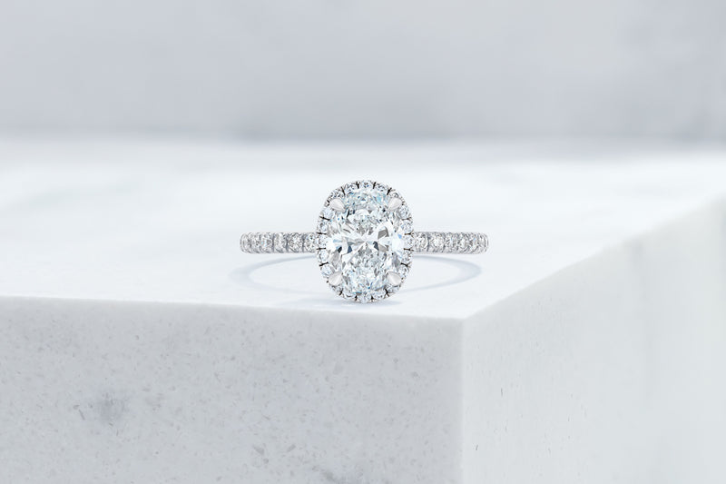 Delancey VOW by Ring Concierge oval halo micropave engagement ring in platinum. 33281357348952