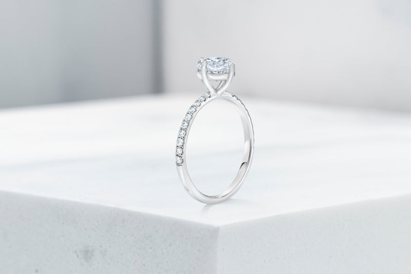 Lafayette VOW by Ring Concierge antique-style cushion north south east west micropave engagement ring in platinum. 33281382613080