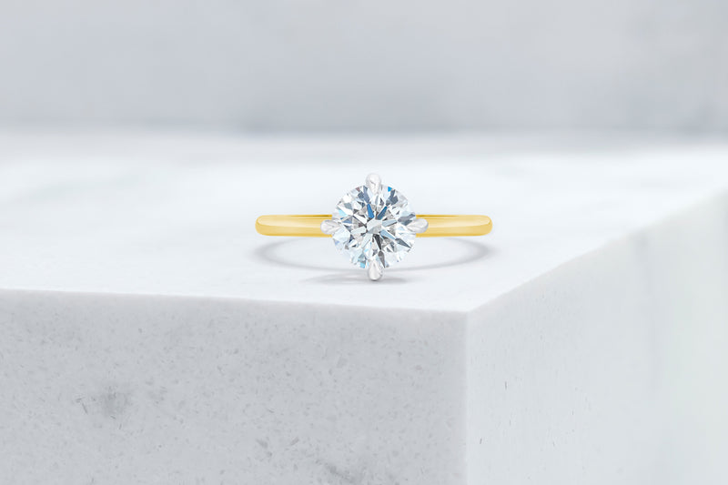 Lenox VOW by Ring Concierge round north south east west prong solitaire engagement ring in yellow gold. 33281398898776