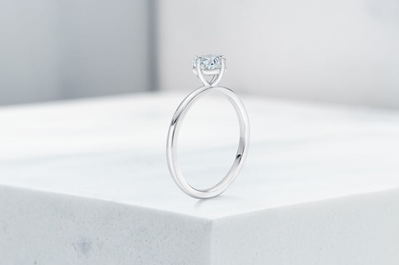 Lenox VOW by Ring Concierge cushion north south east west prong solitaire engagement ring in platinum. 33281399062616