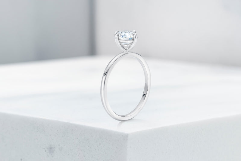 Lenox VOW by Ring Concierge antique-style round north south east west solitaire engagement ring in platinum. 33281399160920