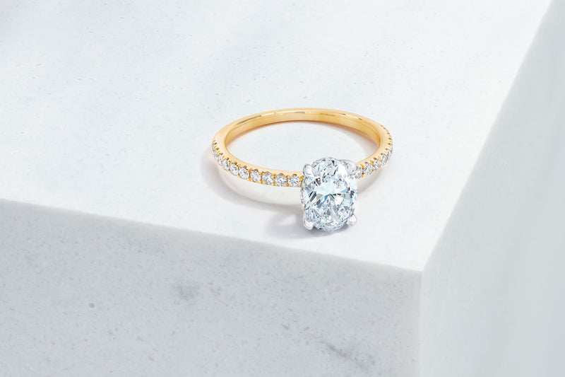 Lexington VOW by Ring Concierge oval micropave engagement ring with hidden halo in yellow gold. 33281433436248