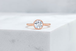 Mercer VOW by Ring Concierge round bezel engagement ring in rose gold. 33281413742680