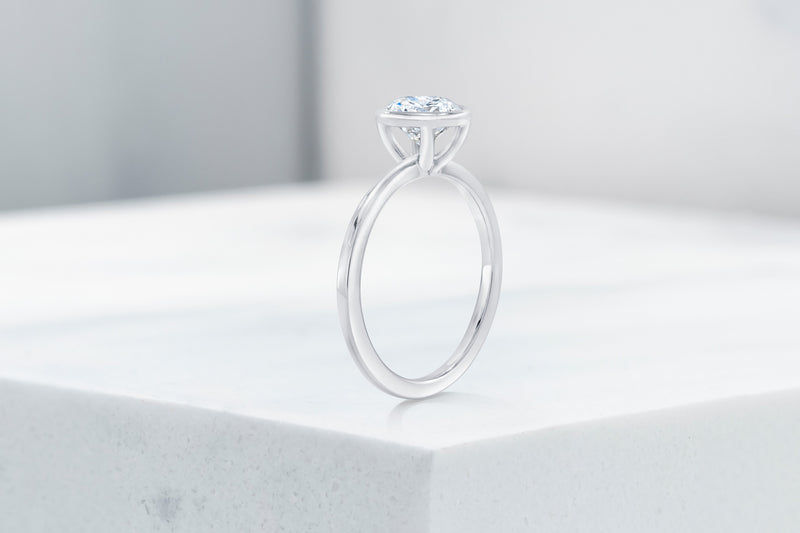 Mercer VOW by Ring Concierge round bezel engagement ring in platinum. 33281413775448