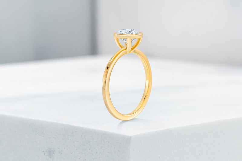 Mercer VOW by Ring Concierge round bezel engagement ring in yellow gold. 33281413709912