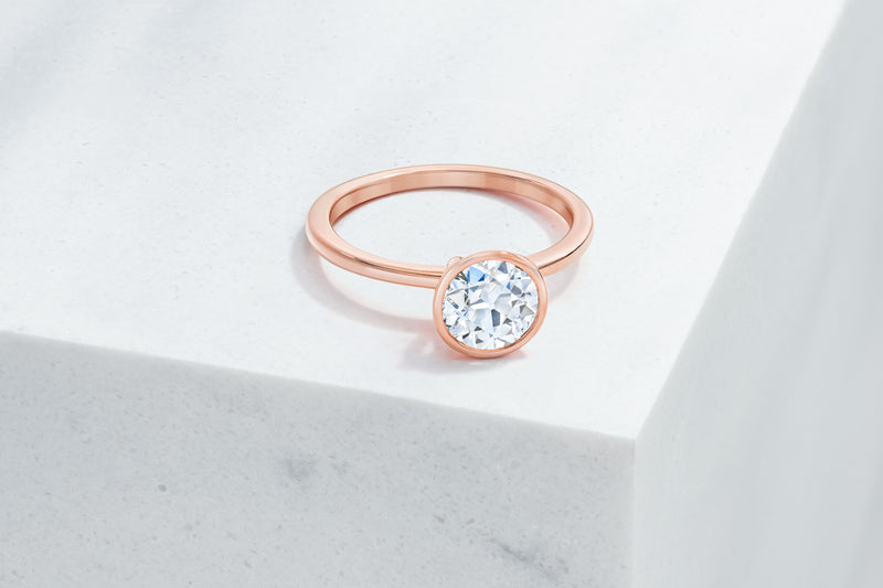 Mercer VOW by Ring Concierge antique-style round bezel engagement ring in rose gold. 33281414266968